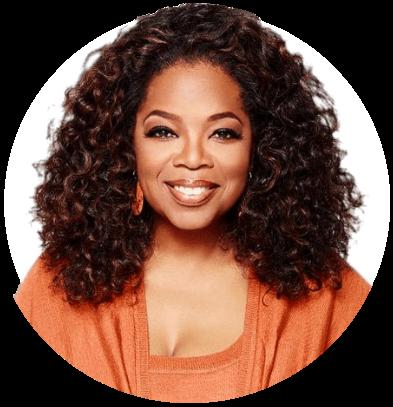 Portrait of Oprah Winfrey wearing an orange top and smiling