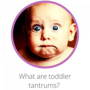 What are toddler tantrums? Contents page. Baby staring wide eyed into the camera, looking concerned and puzzled